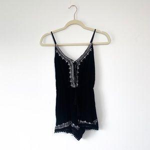Boutique Embroidered Black Tassel Pom Pom Romper